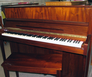 Samick JS-115 45 studio piano in Beautiful Walnut polish.