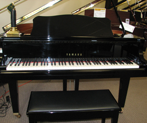 Yamaha GA-1 5' Baby grand piano in ebony polish.